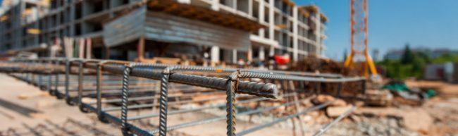 metal-frame-construction-site-with-blurry-plan_220838-118-p5zogyjilj7w8qp7lqli8q1kzxjgy0gu7n3ey4ipl6